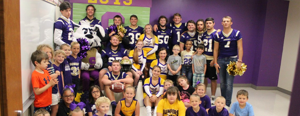 Cecil, SHS football players and cheerleaders visit Hopkins