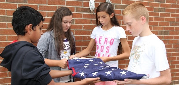 Students honor flag